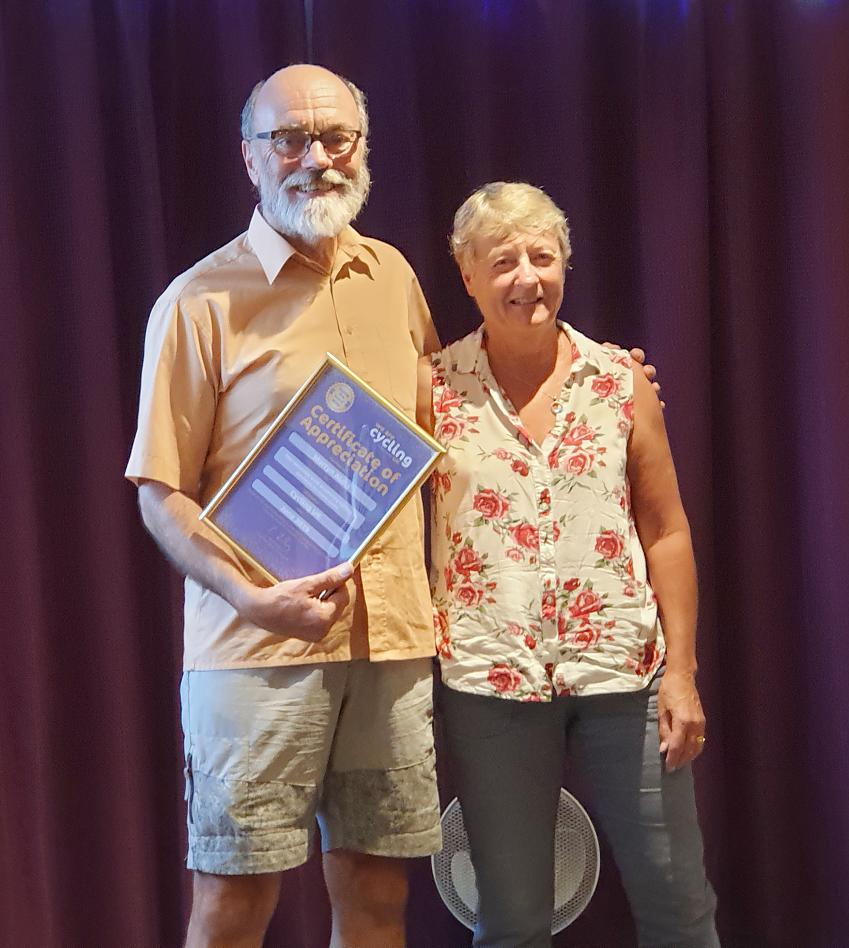 Martyn Aldis, with wife Margaret, receives his Certificate of Appreciation from Cycling UK