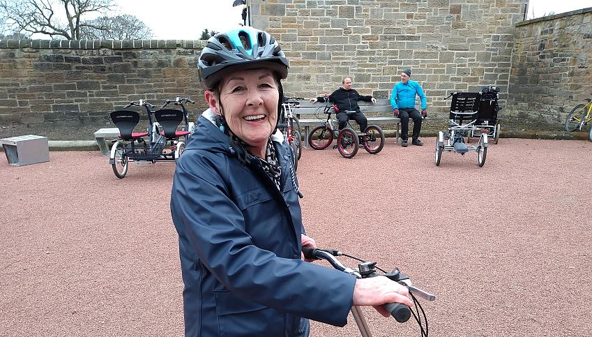 Mary Douglas smiling on her bike