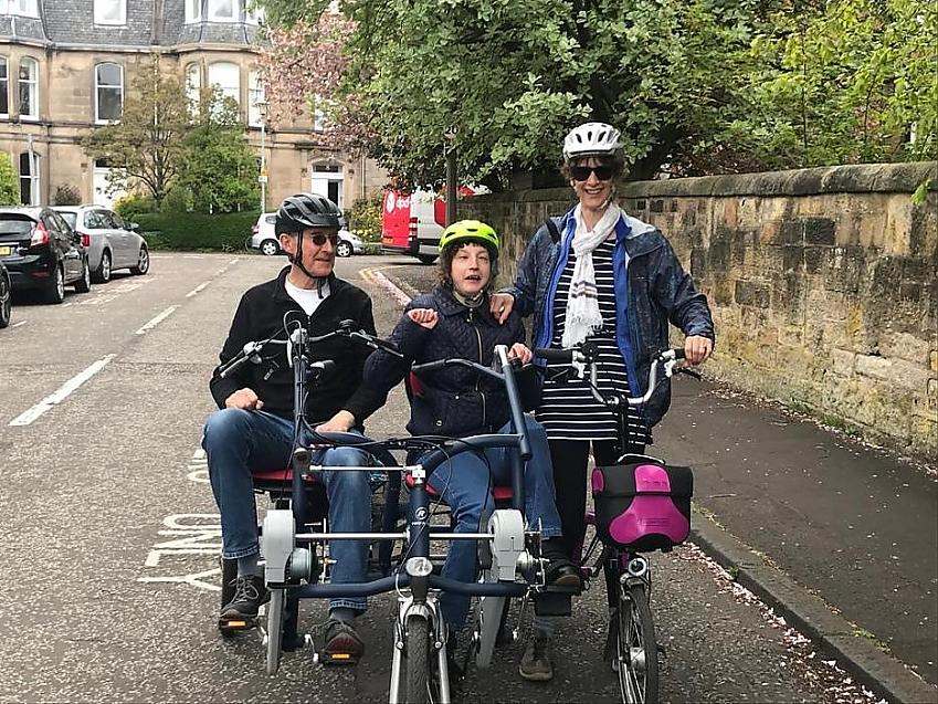Rachel Wilson with her parents on a side-by-side tandem