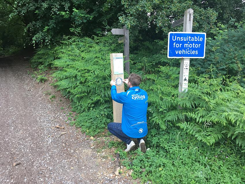 Cycling UK erecting the signage on the Surrey Hills network