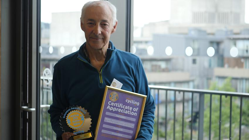 Ted Liddle with his award and certificate