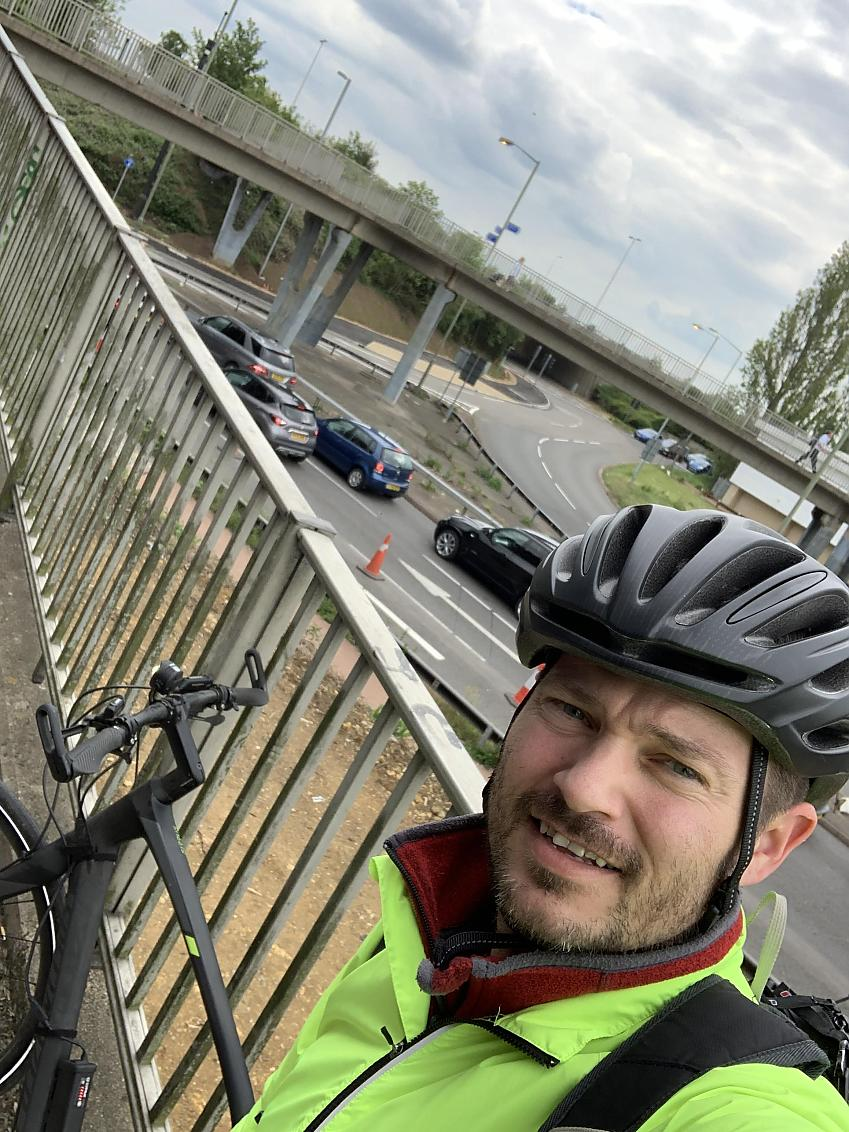 Trevor on the bridge over the busy roundabout