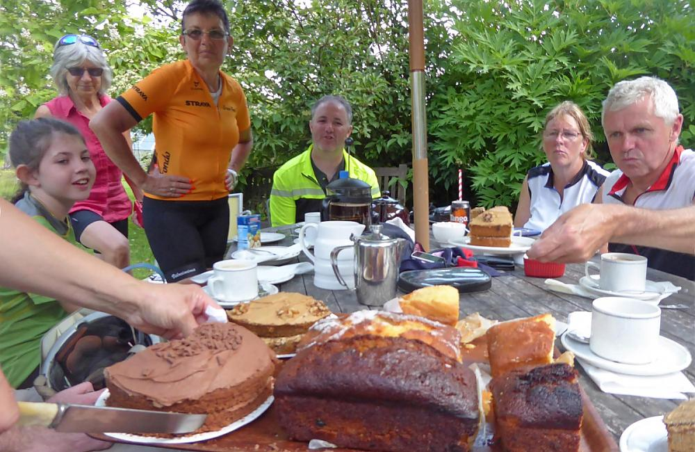 Cyclists eating cake at Annie's