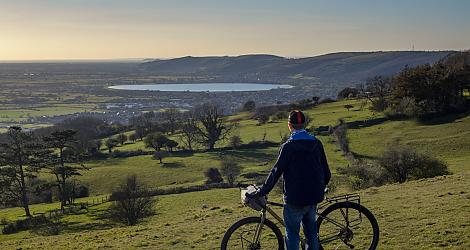 A man and his bike overlooks Cheddar