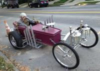 Zombie emerging from a coffin bike
